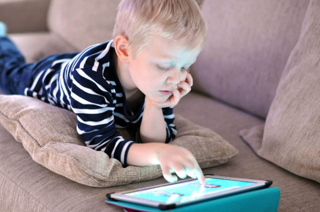 online educational games, boy playing with tablet