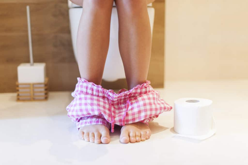 Postpartum Recovery Tips, woman on toilet